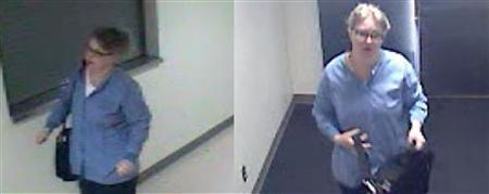 A woman impersonating a nurse whom police say entered Swedish Medical Center and attempted to steal pain medicine from the IV lines of two patients is seen in a still image taken from surveillance video taken in Seattle, Washington April 17, 2013. REUTERS/Seattle Police Department/Handout