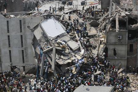 People rescue garment workers trapped under rubble at the Rana Plaza building after it collapsed, in Savar, 30 km (19 miles) outside Dhaka April 24, 2013. REUTERS/Andrew Biraj