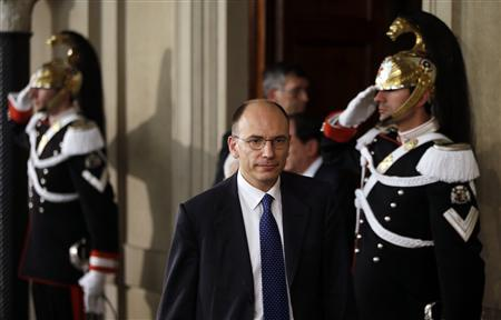 Deputy leader of Italy's centre-left Democratic Party (PD) Enrico Letta arrives to speak to reporters at the Quirinale Palace in Rome April 24, 2013. REUTERS/Max Rossi