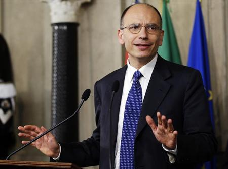 Deputy leader of Italy's centre-left Democratic Party (PD) Enrico Letta gestures as he speaks to reporters at the Quirinale Palace in Rome April 24, 2013. REUTERS/Max Rossi