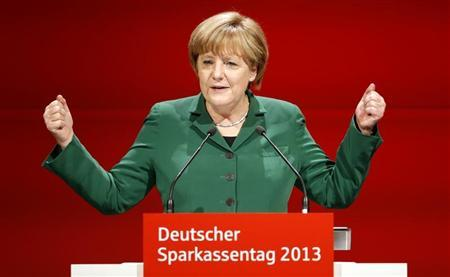 German Chancellor Angela Merkel gestures as she addresses the audience at the annual German Savings Banks Association meeting in Dresden April 25, 2013. REUTERS/Fabrizio Bensch