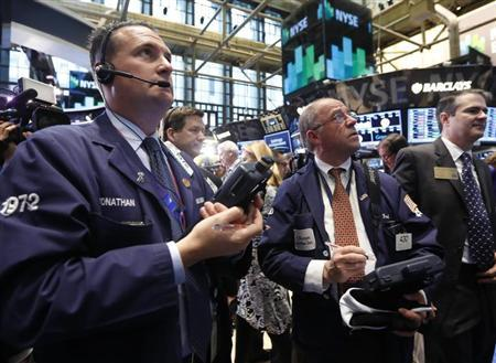 Traders work on the floor at the New York Stock Exchange, April 19, 2013. REUTERS/Brendan McDermid