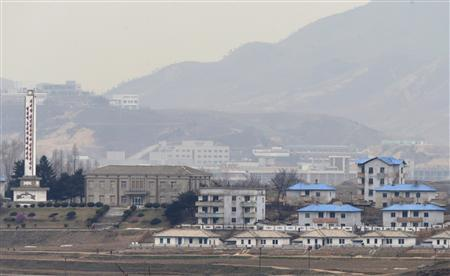 The inter-Korean Kaesong Industrial Complex is seen behind the propaganda village of Gijungdong in North Korea, in this picture taken near the truce village of Panmunjom, just south of the demilitarized zone dividing the two Koreas, in Paju, about 55 km (34 miles) north of Seoul April 23, 2013. REUTERS/Lee Jae-Won