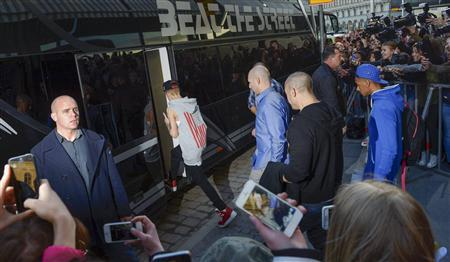 A file picture shows pop singer Justin Bieber as he boards his tour bus outside Grand Hotel for his concert in Stockholm, April 23, 2013. REUTERS/SCANPIX/Leo Sellen