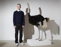 Scottish artist David Shrigley poses next to Ostrich (2009) during the media view of his first major UK exhibition David Shrigley: Brain Activity at the Hayward Gallery in London January 31, 2012. REUTERS/Olivia Harris