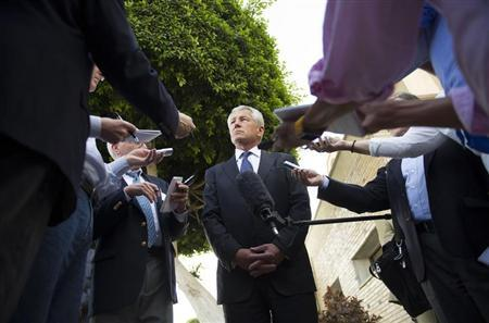 U.S. Secretary of Defense Chuck Hagel speaks with reporters after meeting Egyptian President Mohamed Morsi and Egypt's Defence Minister Abdel Fattah al-Sisi in Cairo, April 24, 2013. REUTERS/Jim Watson/Pool