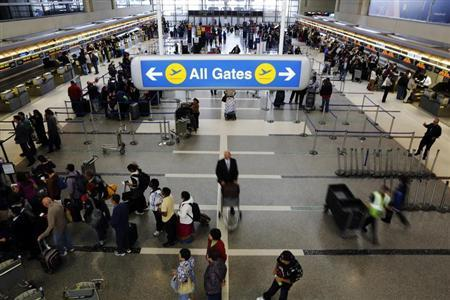 Passengers with their baggage move through the check-in area of the Tom Bradley International Terminal at Los Angeles International Airport (LAX), in Los Angeles, California April 24, 2013. REUTERS/Patrick T. Fallon