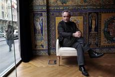 """World-renowned Spanish chef Ferran Adria poses for photographers before the presentation of his latest book """"The Family Meal"""" in Madrid November 14, 2011. REUTERS/Susana Vera"""