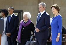 Former U.S. President George W. Bush (2nd R) gives a thumbs up to the audience alongside former first lady Laura Bush (R), during a dedication ceremony for the George W. Bush Presidential Center in Dallas, April 25, 2013. REUTERS/Jason Reed