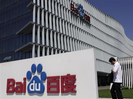 An employee walks past the Baidu company signage outside its headquarters in Beijing, July 26, 2011. REUTERS/Soo Hoo Zheyang