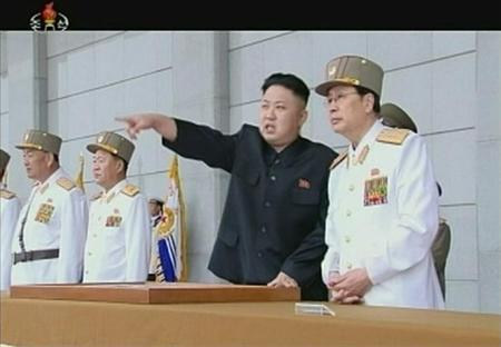North Korean leader Kim Jong-un (2nd R) points during a military ceremony in this still image taken from video footage released on April 25, 2013, by the North's state-run television KRT. REUTERS/KRT via Reuters TV