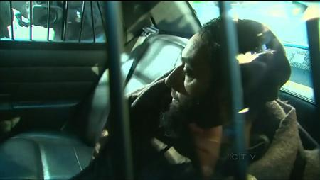 REFILE TO ADD RESTRICTIONS Raed Jaser arrives to court in the back of a police car in Toronto, Ontario, April 23, 2013, in this still image taken from video courtesy of CTV News. REUTERS/CTV News/Handout