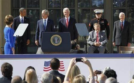 (L-R) Former first lady Laura Bush, President Barack Obama, former President George W. Bush, former President Bill Clinton, former President George H.W. Bush, and former President Jimmy Carter, arrive at the dedication for the George W. Bush Presidential Center on the campus of Southern Methodist University in Dallas, Texas April 25, 2013. REUTERS/Mike Stone