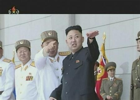 North Korean leader Kim Jong-un (R) gestures during a military ceremony in this still image taken from video footage released on April 25, 2013, by the North's state-run television KRT. REUTERS/KRT via Reuters TV