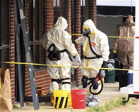 Hazmat officers enter a taekwondo studio previously operated by James Everett Dutschke in Tupelo, Mississippi April 24, 2013. REUTERS/Lauren Wood/Daily Journal