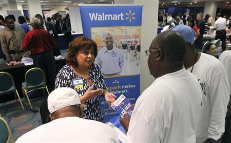 Job candidates receive information about employment at Walmart at a U.S. Congressional Black Caucus Jobs Fair in Miami, Florida August 23, 2011. REUTERS/Joe Skipper