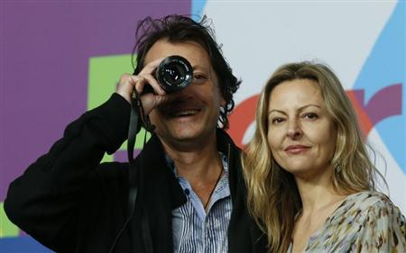Winner of the Best First Feature Award for the movie ''The Rocket'' director Kim Mordaunt poses with producer Sylvia Wilcynski during a news conference after the awards ceremony at the 63rd Berlinale International Film Festival in Berlin February 16, 2013. REUTERS/Tobias Schwarz