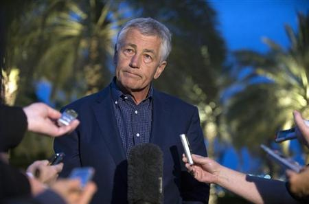 U.S. Secretary of Defense Chuck Hagel speaks with reporters after reading a statement on chemical weapon use in Syria during a news conference in Abu Dhabi April 25, 2013. REUTERS/Jim Watson/Pool