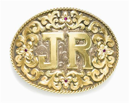A ruby-adorned silver and gold belt buckle from the U.S. television drama ''Dallas'' owned by the late actor Larry Hagman is shown in this publicity photo released to Reuters April 25, 2013. REUTERS/Bonham's/Handout