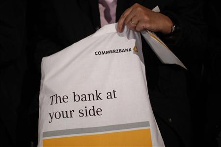 A shareholder holds a Commerzbank bag ahead of the bank's annual shareholder's meeting in Frankfurt, April 19, 2013. REUTERS/Lisi Niesner