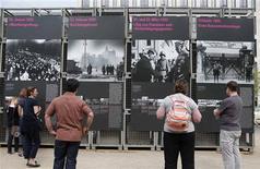 "People watch the open air exhibition ""Diversity Destroyed"" near the Brandenburg Gate in Berlin, April 26, 2013. REUTERS/Fabrizio Bensch"