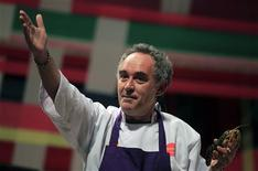 "El Bulli restaurant head chef Ferran Adria gestures while holding a shrimp as he speaks during a conference at the ""Mistura"" gastronomic fair in Lima in this September 11, 2011 file photo. REUTERS/Pilar Olivares/Files"