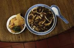 Snake meat is seen in a bowl of snake soup served at a snake soup shop in Hong Kong January 30, 2013. REUTERS/Bobby Yip