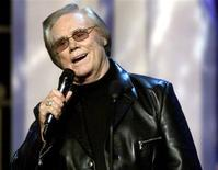 George Jones performs during the Country Music Association Awards in Tennessee, November 6, 2002. REUTERS/Tami Chappell