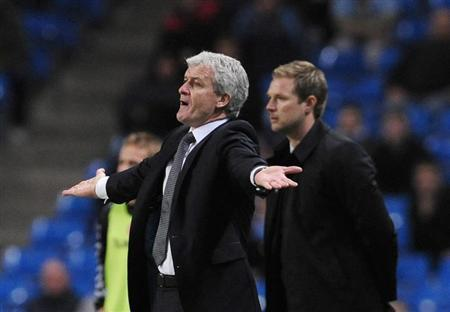 Manchester City's coach Mark Hughes (L) gestures as AaB Aalborg's coach Magnus Pehrsson watches during their UEFA Cup soccer match in Manchester, northern England, March 12, 2009. REUTERS/Nigel Roddis