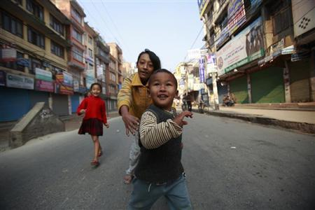 Children play at the main road during the nationwide strike called by the Communist Party of Nepal-Maoist in Kathmandu March 6, 2013. REUTERS/Navesh Chitrakar