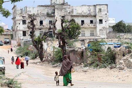 An internally displaced woman walks along a war-ravaged street in Hodan district of Somalia's capital Mogadishu, September 6, 2011. REUTERS/Feisal Omar