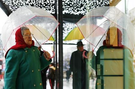 A woman looks at a window display on Oxford Street in central London December 20, 2012. REUTERS/Olivia Harris
