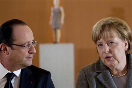 German Chancellor Angela Merkel (R) and French President Francois Hollande arrive for a dinner with representatives of the European Round Table of Industrialists at the Chancellery in Berlin March 18, 2013. REUTERS/Johannes Eisele/Pool