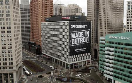 A view of downtown Detroit is seen looking south on Woodward Avenue including one of several buildings (with the Made In Detroit banner) recently purchased by Quicken Loans founder Dan Gilbert in Detroit, Michigan January 30, 2013. REUTERS/Rebecca Cook/Files