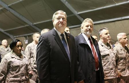 Secretary of the Air Force Michael Donley (L, front) attends a ceremony, marking the 10th anniversary of the presence of the U.S. transit center in Kyrgyzstan, at the Manas airport near Bishkek December 21, 2011. REUTERS/Vladimir Pirogov