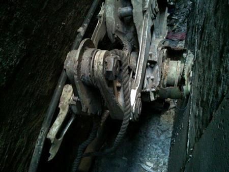 A part of the landing gear, apparently from one of the commercial airliners destroyed on September 11, 2001, is seen wedged between two buildings in New York in this handout photo released by the NYPD on April 26, 2013. REUTERS/NYPD/Handout
