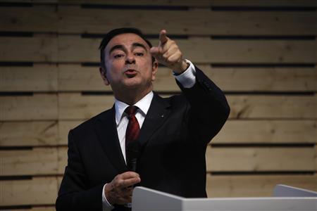 Carlos Ghosn, chairman and chief executive officer of French carmaker Renault, speaks with journalists during a meeting to promote the new electric car Renault Zoe in Lisbon March 14, 2013. REUTERS/Rafael Marchante