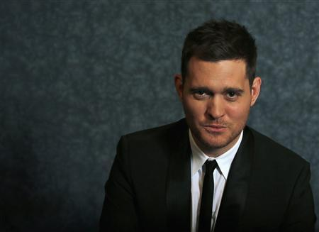 Canadian singer Michael Buble poses for a portrait while promoting his new album 'Michael Buble: To Be Loved' in New York April 25, 2013. REUTERS/Brendan McDermid