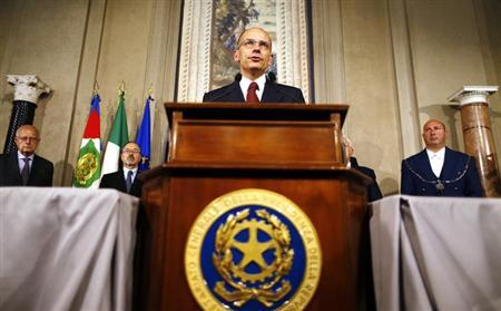 Italian Prime Minister-designate and deputy leader of the centre-left Democratic Party (PD) Enrico Letta speaks to reporters at the Quirinale Palace in Rome, April 27, 2013. REUTERS/Alessandro Bianchi