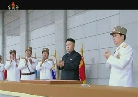 North Korean leader Kim Jong-un (2nd R) applauds during a military ceremony in this still image taken from video footage released on April 25, 2013, by the North's state-run television KRT. REUTERS/KRT via Reuters TV