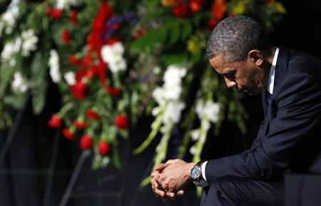 U.S. President Barack Obama bows his head during a memorial service for the victims of the West, Texas fertilizer plant explosion last week, at Baylor University in Waco, Texas, April 25, 2013. REUTERS/Richard Rodriguez