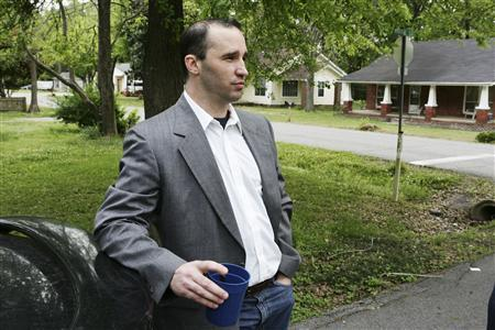 Everett Dutschke waits for federal authorities to search his home in Tupelo, Mississippi, April 23, 2013. REUTERS/Thomas Wells/Daily Journal