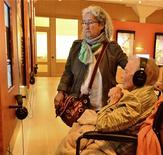 Nora Guthrie (L), daughter of Woody Guthrie and sister to Arlo Guthrie, and Mary Jennings Boyle, 96, the first wife of Woody Guthrie, watch a multimedia presentation of Woody Guthrie's early years in the Texas panhandle at the Woody Guthrie Center in Tulsa, Oklahoma, April 26, 2013. Woody Guthrie, before he became famous, met and later married Jennings Boyle in Pampa, Texas, in a union that eventually ended in divorce. Nora Guthrie, now 63, is the youngest daughter from Woody Guthrie's second marriage and has played a major role in preserving his archives. REUTERS/Steve Olafson