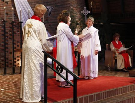 Rosemarie Smead (2nd R), a 70-year-old Kentucky woman, is ordained a Roman Catholic priest during a Celebration of Ordination at St. Andrew's United Church of Christ in Louisville, Kentucky April 27, 2013. Smead was ordained as part of a dissident group operating outside official Roman Catholic Church authority. REUTERS-John Sommers II