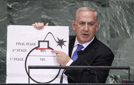 Israel's Prime Minister Benjamin Netanyahu points to a red line he has drawn on the graphic of a bomb as he addresses the 67th United Nations General Assembly at the U.N. Headquarters in New York, September 27, 2012. REUTERS/Lucas Jackson