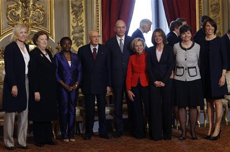 (L-R) Josefa Idem, Anna Maria Cancellieri, Cecile Kyenge, Italian President Giorgio Napolitano, Prime Minister Enrico Letta, Emma Bonino, Beatrice Lorenzin, Maria Chiara Carrozza and Nunzia De Girolamo pose for a family photo after 21 sworn ministers were sworn in, at Quirinale palace in Rome, April 28, 2013. REUTERS- Remo Casilli