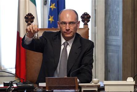 Newly appointed Prime Minister Enrico Letta rings the silver bell, to signify the start of his first cabinet meeting at Chigi palace in Rome, April 28, 2013. REUTERS- Giampiero Sposito