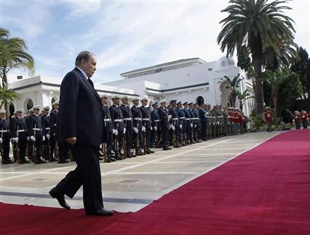 Algeria's President Abdelaziz Bouteflika walks towards Spain's Prime Minister Mariano Rajoy (not pictured) during a welcoming ceremony at the presidential palace in Algiers January 10, 2013. REUTERS/Louafi Larbi