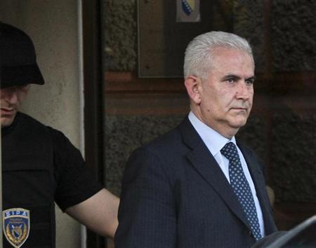 Members of the special police arrest President of Bosnia's autonomous Muslim-Croat federation Zivko Budimir (R) in Sarajevo April 26, 2013. REUTERS/Stringer