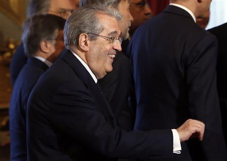 New Italian Economy Minister Fabrizio Saccomanni smiles during the swearing in ceremony of the new government at Quirinale palace in Rome April 28, 2013. REUTERS/Remo Casilli